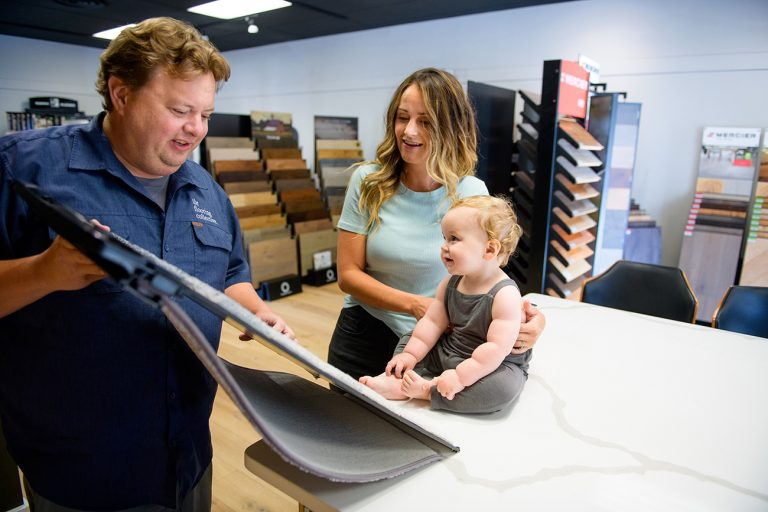 image of employee helping mother choose options for her home